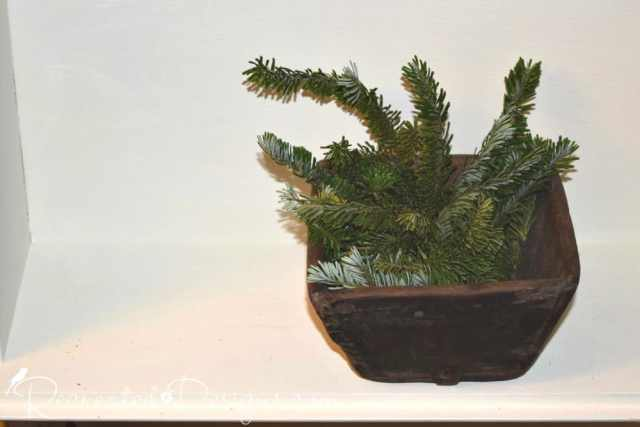 greenery brought inside for the Holidays in an antique berry basket