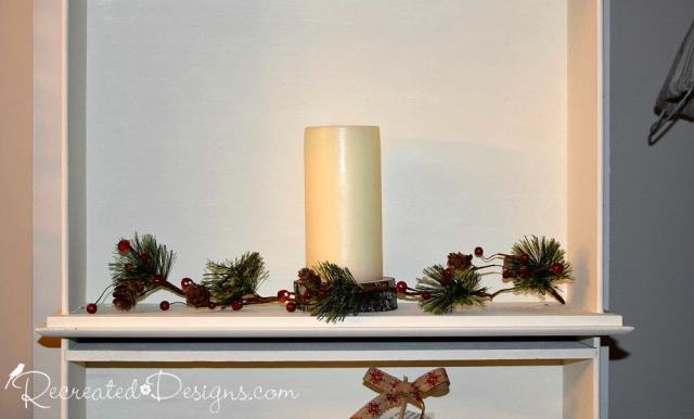 candle and Holiday greenery with berries