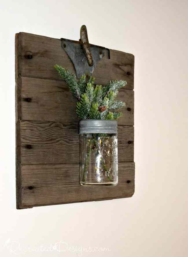 antique mason jar and reclaimed wood filled with greenery
