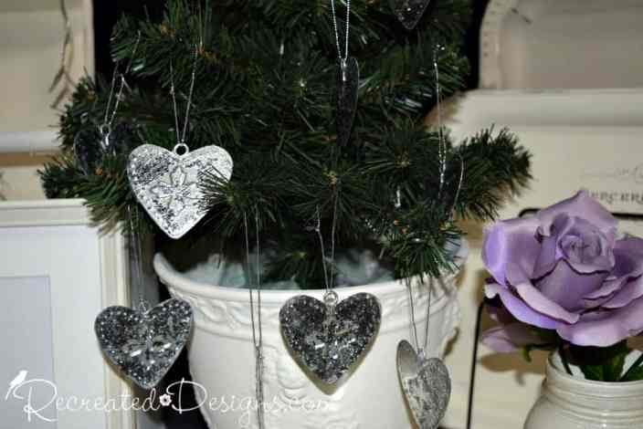 small potted tree with tin hearts hanging from it