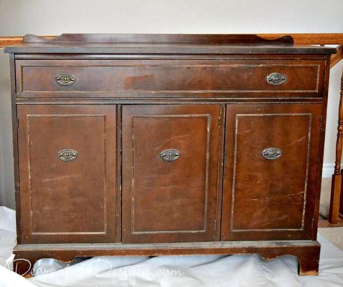 old antique buffet in bad shape
