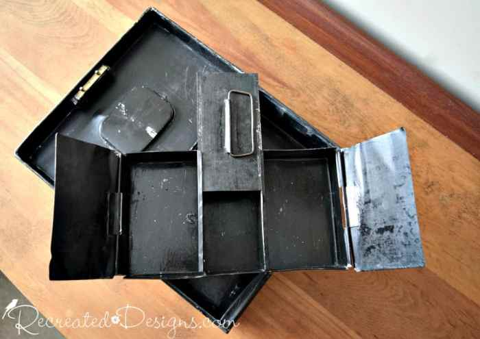 compartments of an old tin cashbox