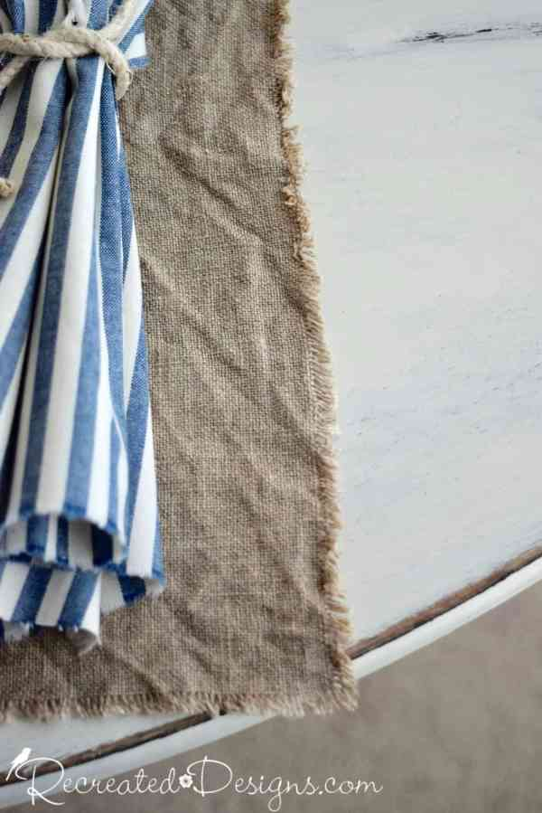 old linen cloth with blue striped napkin