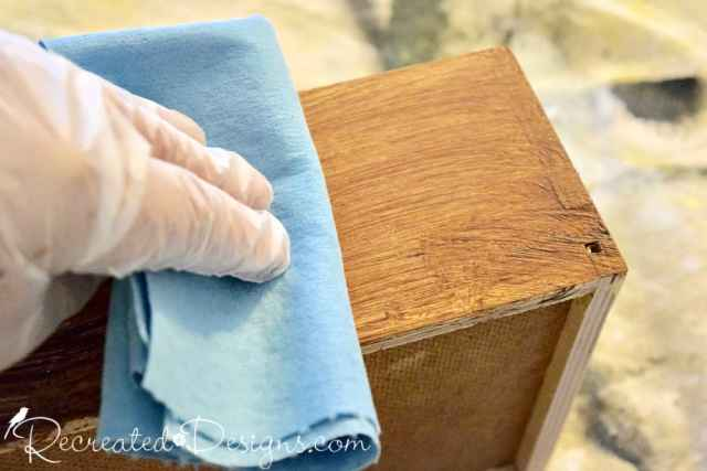 rubbing off excess stain with a shop towel