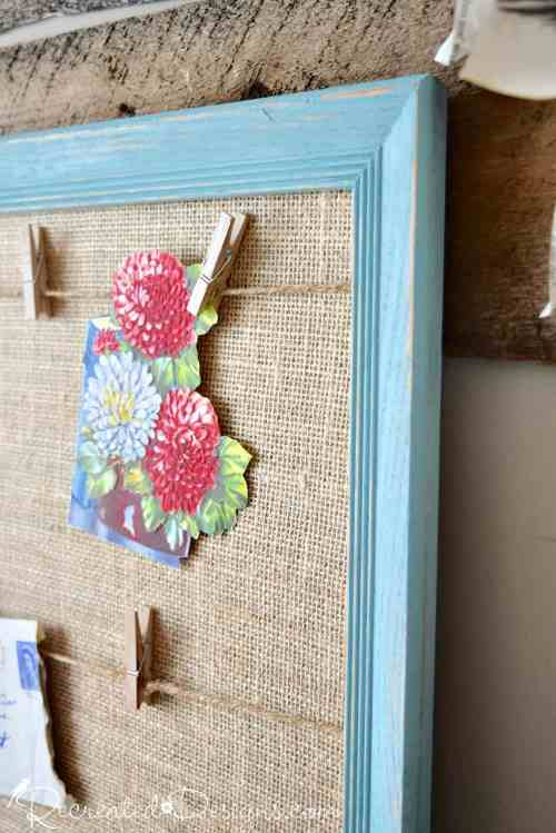 vintage flowers from a card hanging on a memory board