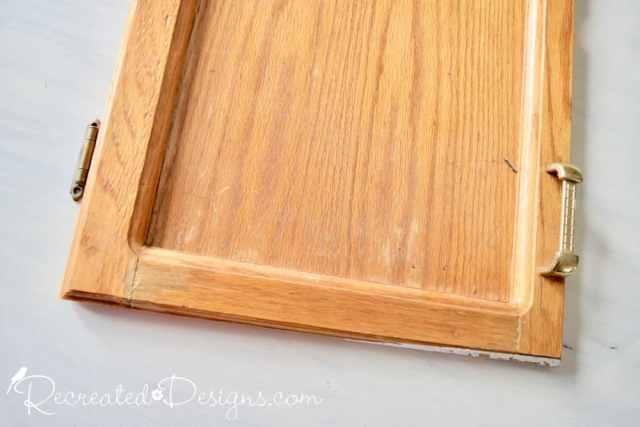 reclaimed kitchen cabinet door before diy project