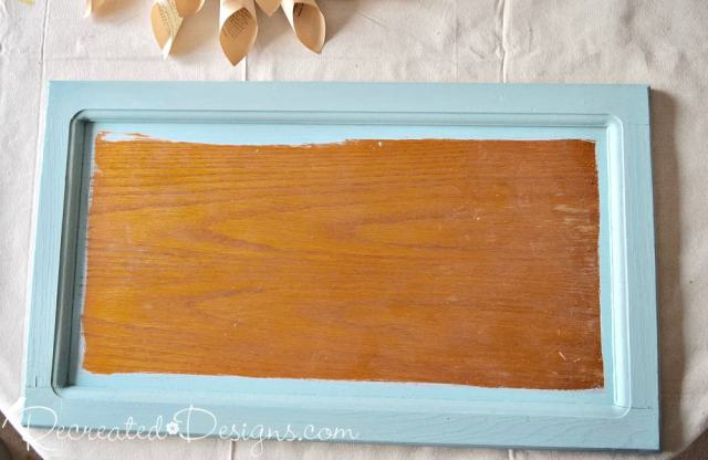 painted a cabinet door with Homestead House Paint in Laurentien