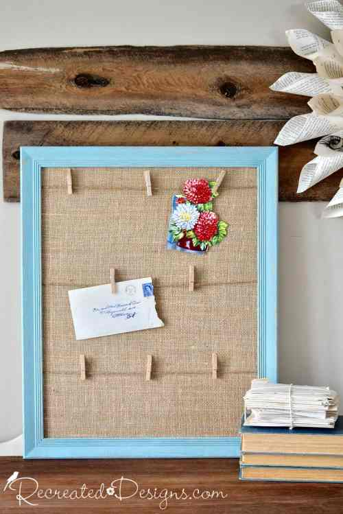 gorgeous blue memory board with burlap and clothes pins for hanging letters and pictures on