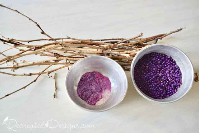 twigs, purple glitter and purple beads
