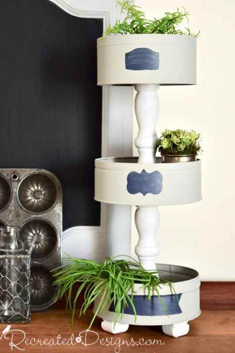 home decor tiered stand made from upcycled tin cans