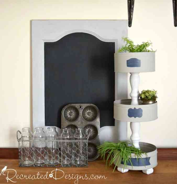 making a tiered stand out of upcycled cookie tins