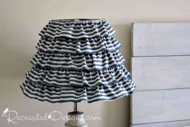 old lamp shade recreated with hot glue and vintage inspired striped fabric