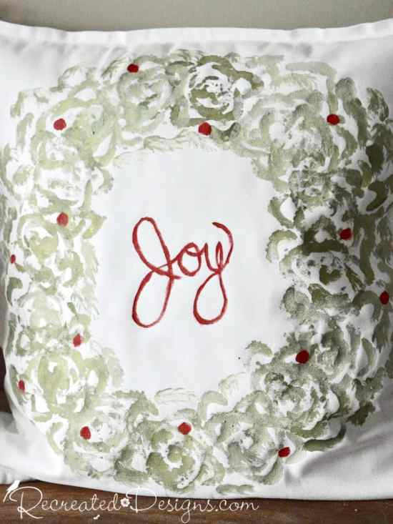 Joy Christmas pillow using milk paint and celery