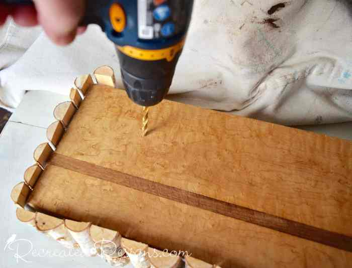 drilling holes in old cutting board for twig Christmas trees