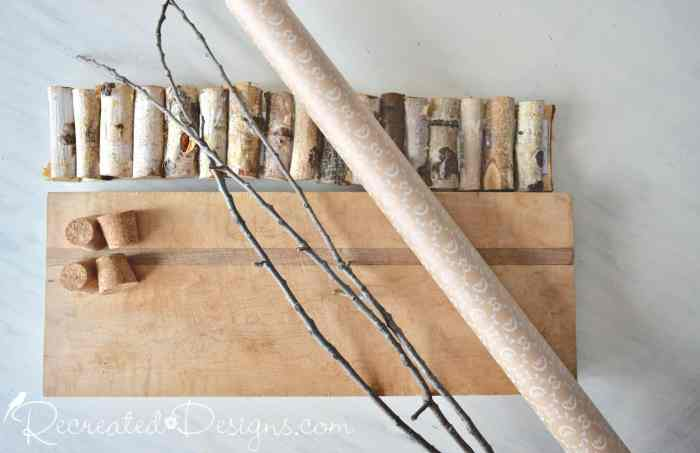 old cutting board, wrapping paper and twigs