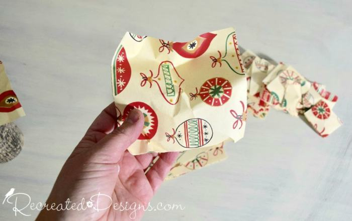 crinkling paper squares to make a Christmas tree