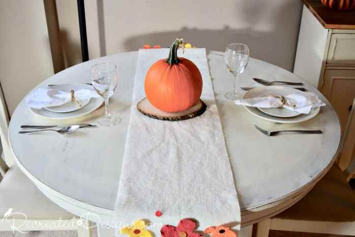 pumpkin on a fall table runner
