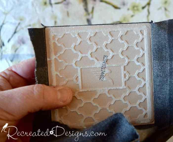 attaching fabric to ceramic tiles