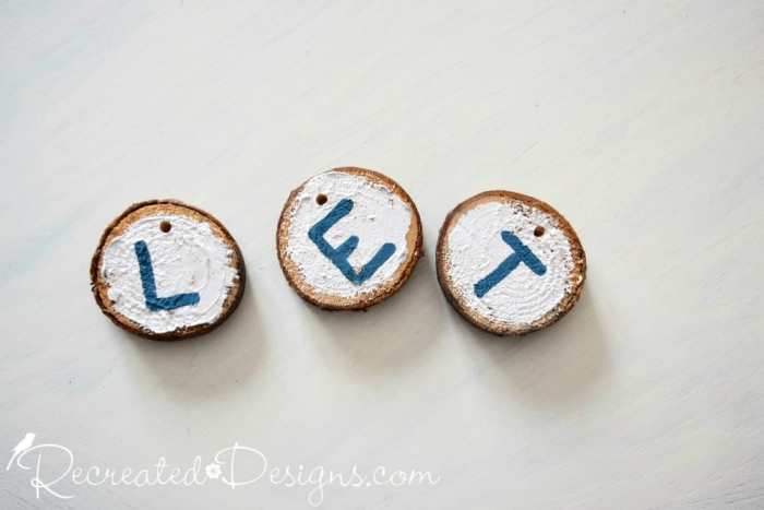 Wood slices painted with Metallic Pearl paint with blue letters