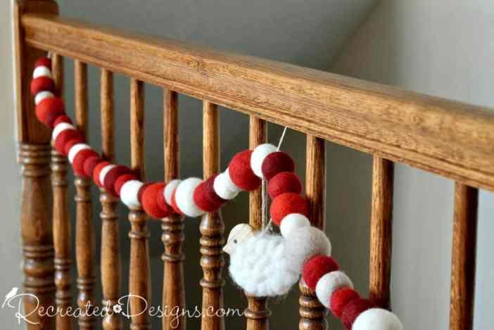 natural wool Christmas garland hanging on banister