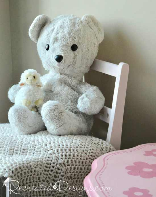 vintage teddy bear sitting on child's chair