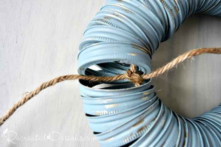 tying Mason jar ring together with twine