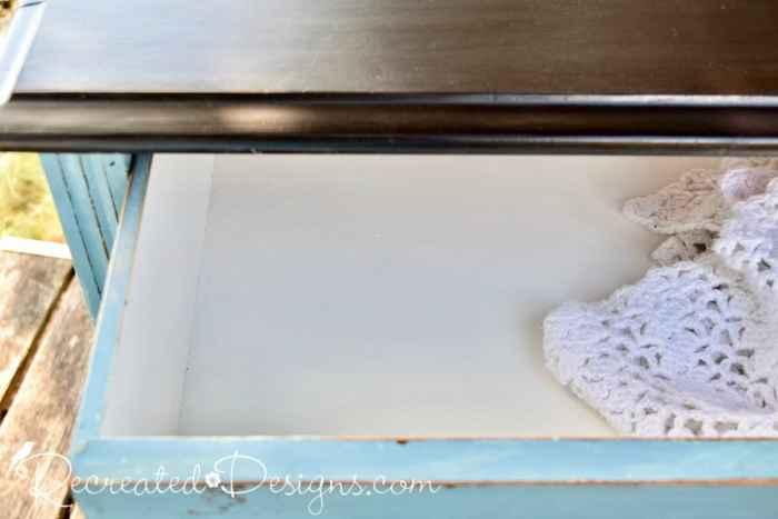 painted drawers inside a vintage dresser