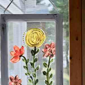 using Country Chic Paint to hand paint flowers on a window