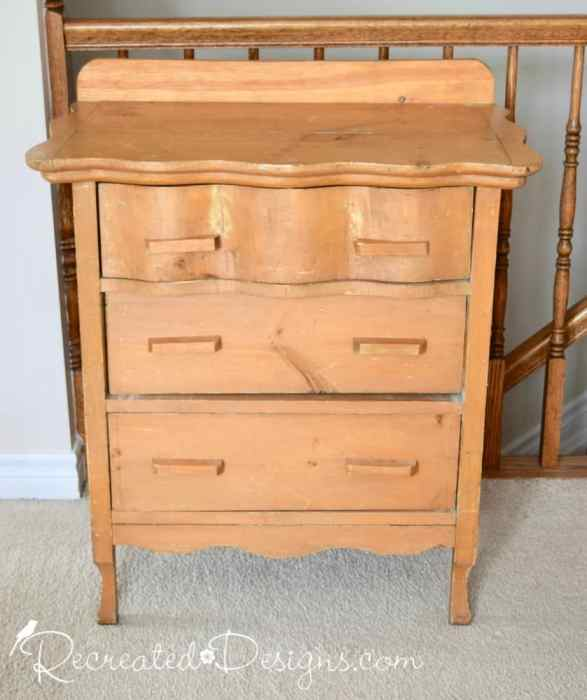 an old hand crafted dresser from the Habitat for Humanity store