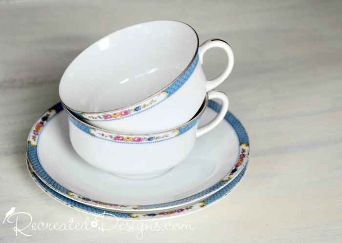 vintage fine china with pink flowers and blue trim
