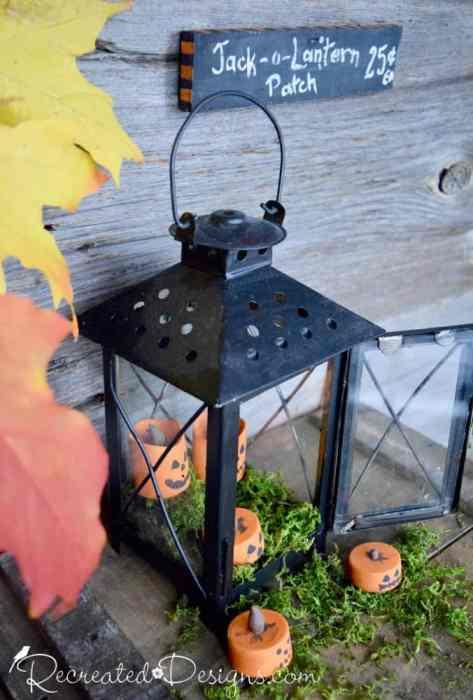 tea lights painted to look like Halloween Jack-o-Lanterns