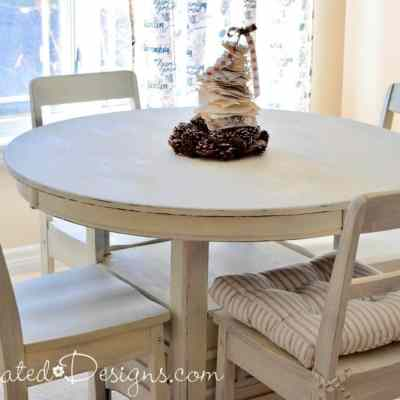 painted dining room set with one chair pad