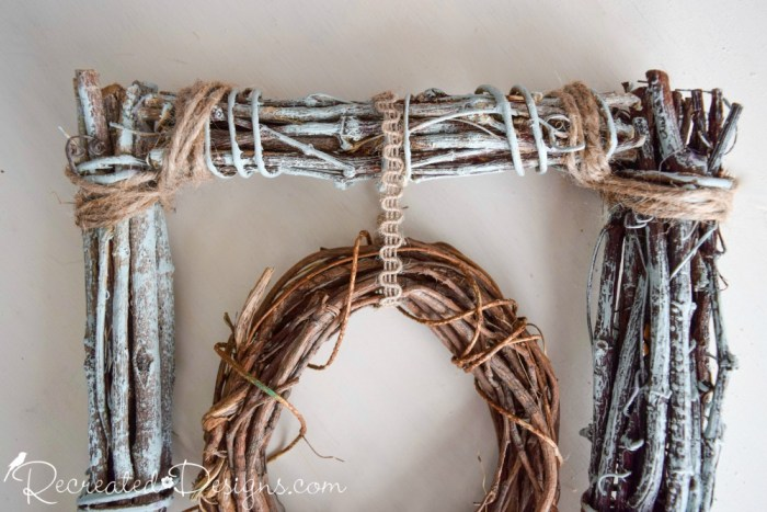 hanging a grapevine wreath to make a bird feeder