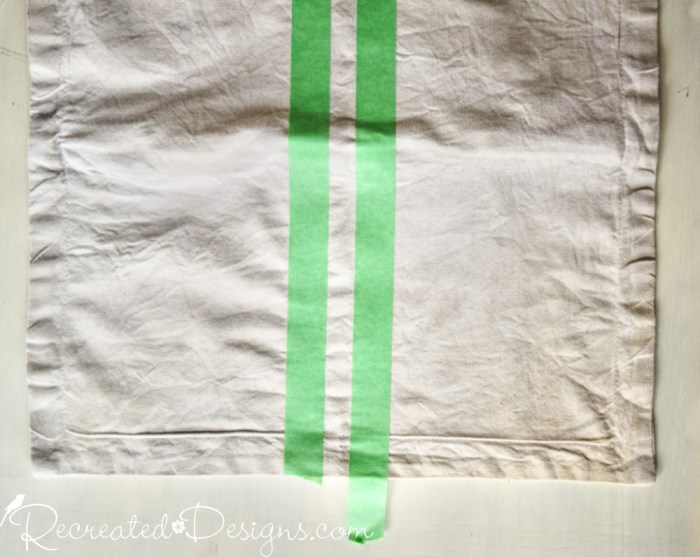 taping a pillow cover to add stripes