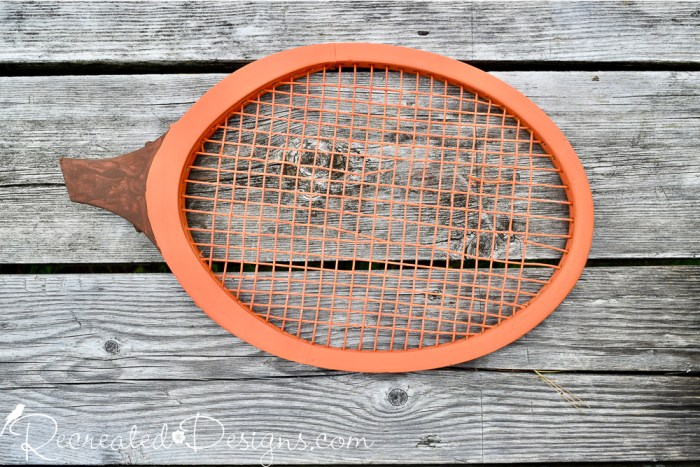tennis racket painted orange