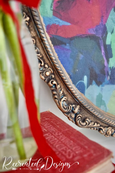 details on a vintage mirror painted gold