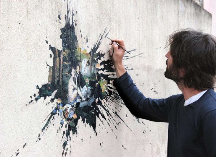 Pejac haciendo street art