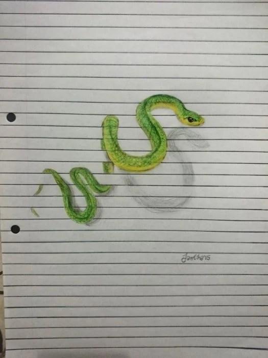 dibujo serpiente en libreta