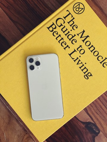 iPhone 11 Pro rear view in silver atop the Monocle Guide To Better Living