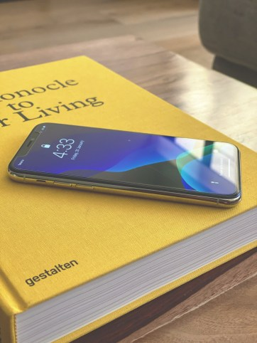 iPhone 11 Pro in silver atop the Monocle Guide To Better Living