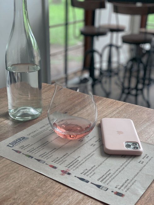 Wine glass on a table at Usher Tinkler winery.