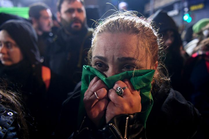 An abortion rights supporter reacts in Buenos Aires after lawmakers rejected the bill to legalize abortion.