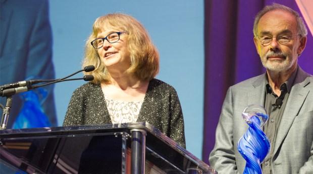 Jan Walker and Dr. Tom Delbanco speak at a podium.