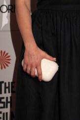 Hayley Atwell in Jimmy Choo clutch