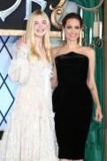 Elle Fanning in Alexander McQueen and Angelina Jolie in Atelier Versace