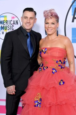 Carey Hart and Pink In Monique Lhuillier