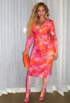 Beyonce's Three New Looks In Versace, Michael Costello & Mugler