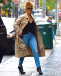 Jennifer Lopez Rocks The  Coach x Jean-Michel Basquiat Trench Coat Out In New York City