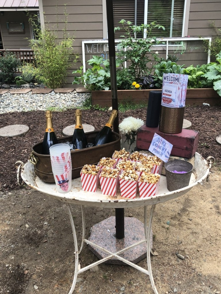 family party idea: champagne and popcorn at welcome station