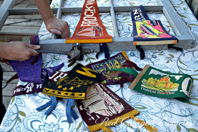 Upcycle challenge uses an old window frame to display an collection of vintage pennants